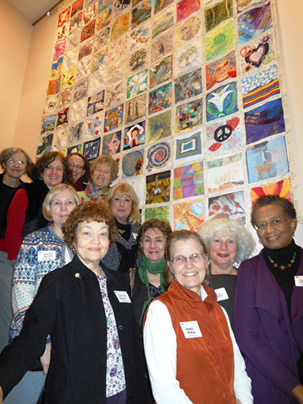 artists with peace quilt